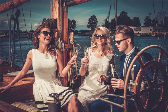 adults enjoying champagne on a yacht
