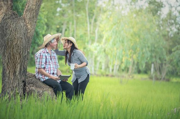 Happy couple in a field